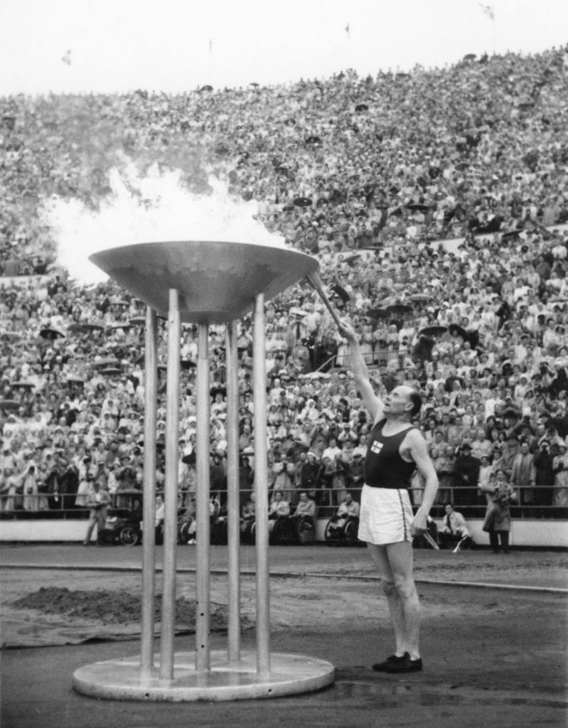 Paavo Nurmi lights the Olympic flame